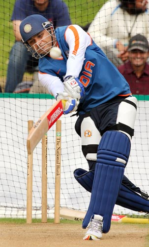 Virender Sehwag lofts a ball away during training in Wellington on March 5, 2009. (AFP Photo)
