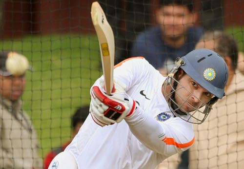 Yuvraj Singh slams a ball in the nets during training in Wellington on March 5, 2009. (AFP Photo)