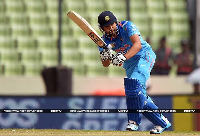Indian opener Rohit Sharma got off to a confident start, pulling and hooking deliveries from Pakistan pacers after Shikhar Dhawan was dismissed early by Mohammed Hafeez (All images AP and AFP)