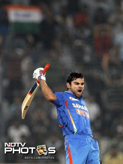 Despite Pakistan posting a massive 329 after batting first, India's Virat Kohli 183 from 148 balls to take his team home.(AP Photo)