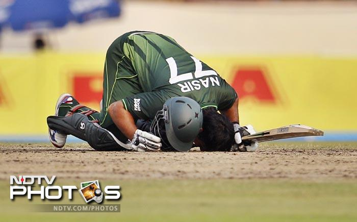 Nasir Jamshed bows his head to touch the ground to celebrate scoring a century during the 5th ODI of the Asia Cup between India and Pakistan at the Sher-e-Bangla National Cricket Stadium in Dhaka. (AP Photo)