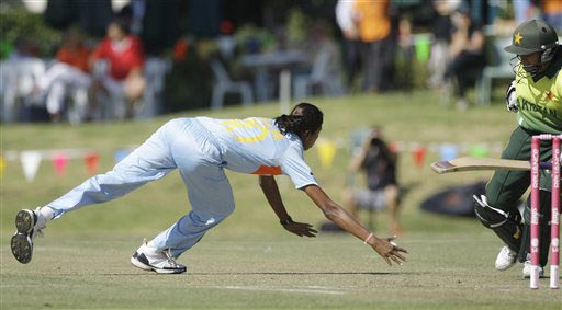 Pakistan's Bismah Mahroof, right, hurries back to her crease as India's captain Jhulan Goswami fields from her own bowling during their Women's World Cup cricket match at the Bradman Oval in Bowral on Saturday, March 7, 2009. (AP Photo)