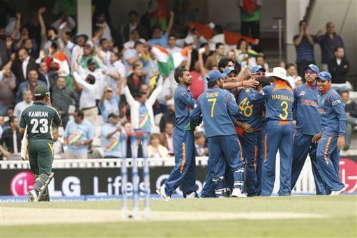 Indian players celebrate the wicket of Kamran Akmal during their Twenty20 World Championship warm-up match at the Oval in London. (AP Photo)