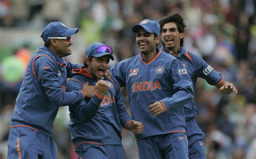 Suresh Raina celebrates with teammates after running out Ahmad Shehzad in their warm up match for the Twenty20 World Championship at the Oval in London. (AP Photo)