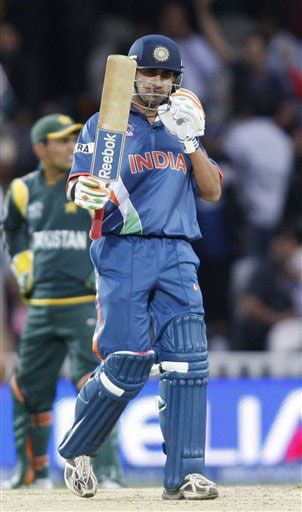 Gautam Gambhir reacts to his half-century after playing a shot off the bowling of Umar Gul during their Twenty20 World Championship warm-up match at the Oval in London. (AP Photo)