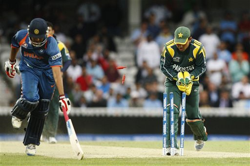 Rohit Sharma runs in safely as wicketkeeper Kamran Akmal hits the wicket during their Twenty20 World Championship warm-up match at the Oval in London. (AP Photo)