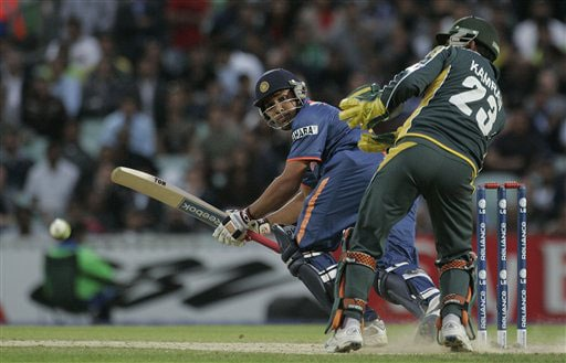 Kamran Akmal looks on as Rohit Sharma scores four runs in their warm up match for the Twenty20 World Championship at the Oval in London. (AP Photo)