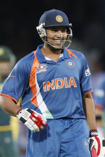Rohit Sharma reacts to his half-century after playing a shot off the bowling of Saeed Ajmal during their Twenty20 World Championship warm-up match at the Oval in London. (AP Photo)