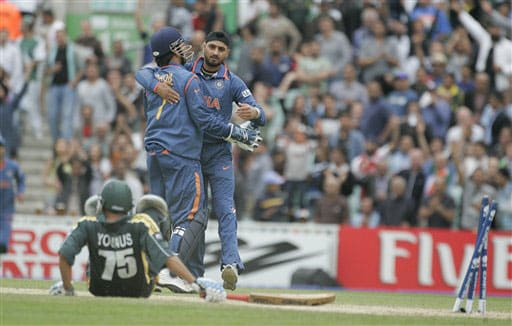 Younis Khan lies on the floor after being stumped by Mahendra Singh Dhoni, second left, as he celebrates with bowler Harbhajan Singh in their warm up match for the Twenty20 World Championship at the Oval in London. (AP Photo)