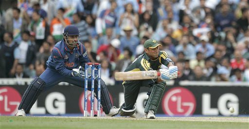 Younis Khan hits out as wicketkeeper Mahendra Singh Dhoni looks on in their warm up match for the Twenty20 World Championship at the Oval in London. (AP Photo)