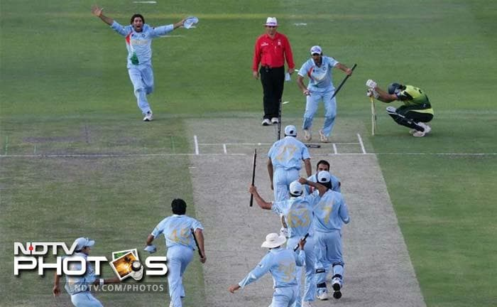 <b>2007 ICC T20 World Cup Final:</b> After the thrilling group encounter, the two archrivals met again - this time for the title. It again went down to the wires. The gamble of asking Joginder Sharma to bowl the last over paid for Dhoni. When Misbah scooped the last delivery for six, a billion hearts skipped a beat and then all eyes turned to Sreesanth, who was right under the ball. As soon as he took the catch, the entire nation erupted into celebrations. The title was an important achievement after India's disappointing 50-over World Cup exit in the Caribbean. It was India's first World title after the 1983 World Cup title.