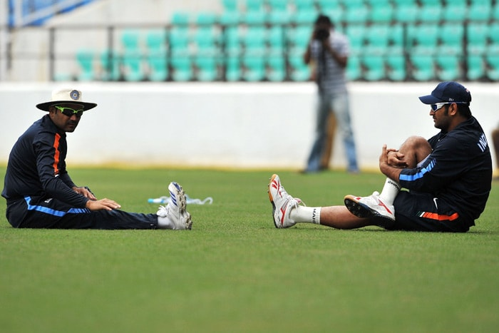 Indian cricketers Virender Sehwag and Mahendra Singh Dhoni stretch during a practice session in Nagpur. The first of the two-match Test series begins at the new Vidarbha Cricket Association ground on the outskirts of the city on February 6. (AFP Photo)