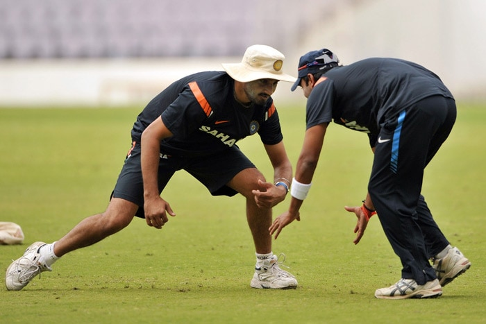 Harbhajan Singh plays with Amit Mishra during a practice session in Nagpur. (AFP Photo)