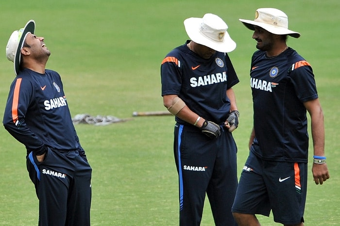 Virender Sehwag shares a joke with teammate Harbhajan Singh (R) during a practice session in Nagpur. (AFP Photo)