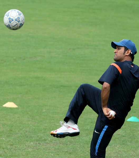 Indian skipper M S Dhoni plays with a football during a practice session at MAC Stadium in Chennai. (PTI Photo)