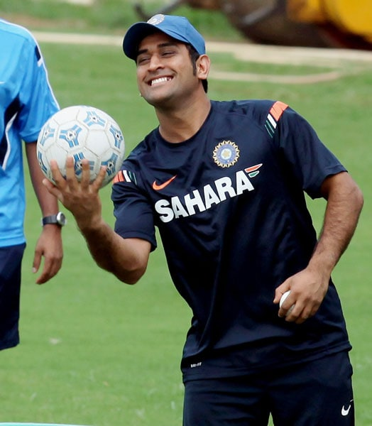 M S Dhoni holds football during a practice session at MAC Stadium in Chennai. (PTI Photo)