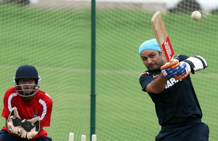 Virender Sehwag plays a shot during a practice session at MAC Stadium in Chennai. (PTI Photo)