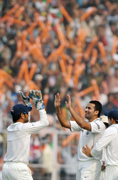 Winning the toss, South Africa had elected to bat but Zaheer Khan's fiery spell and Harbhajan Singh's spin restricted them for just 296 runs despite centuries from Hashim Amla and debutant Alviro Petersen. <br><br>Harbhajan, who was under scrutiny after his failure in the Nagpur Test, picked three wickets on his favourite hunting ground. <br><br>However, Zaheer Khan was the wrecker-in-chief in the first innings as he picked four wickets and executed a terrific run-out. (AFP Photo)