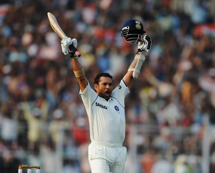 India came out to bat on Day 2 and were off to a good start before a miscommunication between Virender Sehwag and Gautam Gambhir resulted in latter's dismissal. However, Sehwag compensated for it with a swashbuckling 165 runs. <br><br>Master blaster Sachin Tendulkar too raised his 47th Test ton which was subdued yet a solid one. (AFP Photo)