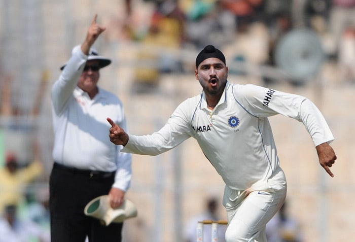 India opened the bowling on the fifth day with Virender Sehwag. In the first session, India managed to pick four wickets. Harbhajan dismissed Ashwell Prince, JP Duminy and Dale Steyn, while Amit Mishra dismissed AB de Villiers. (AFP Photo)