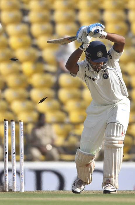 Bails fly as India's Murali Vijay is bowled out by South Africa's Dale Steyn during the third day of the first Test match in Nagpur. (AP Photo)