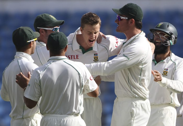 Morne Morkel celebrates taking the wicket of Gautam Gambhir during the third day of the first Test match in Nagpur. (AP Photo)