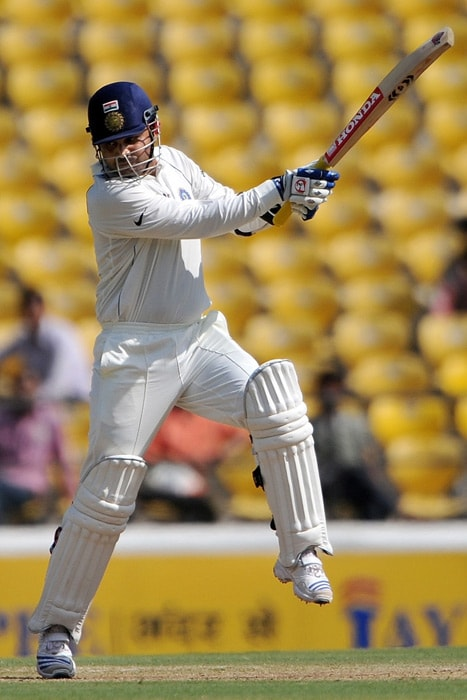 Virender Sehwag plays a shot on the third day of the first Test match between India and South Africa in Nagpur. (AFP Photo)