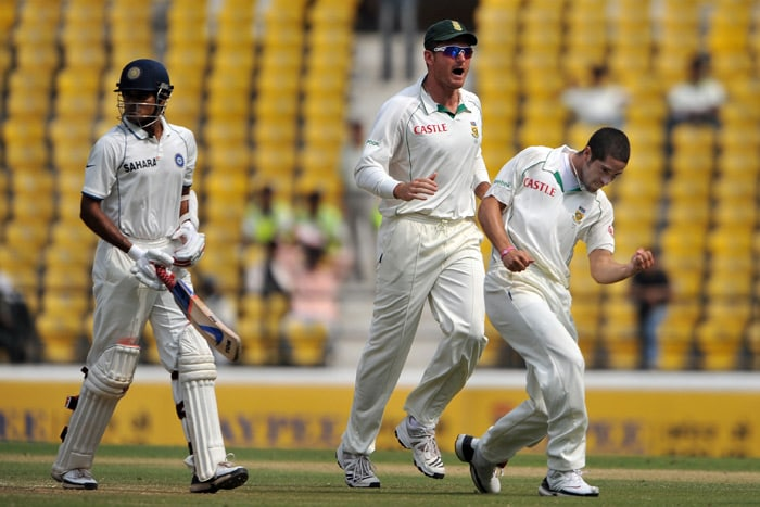 Subramaniam Badrinath walks back to the pavilion as Graeme Smith and Wayne Parnell celebrate his dismissal on the fourth day of the first Test match between India and South Africa in Nagpur. (AFP Photo)