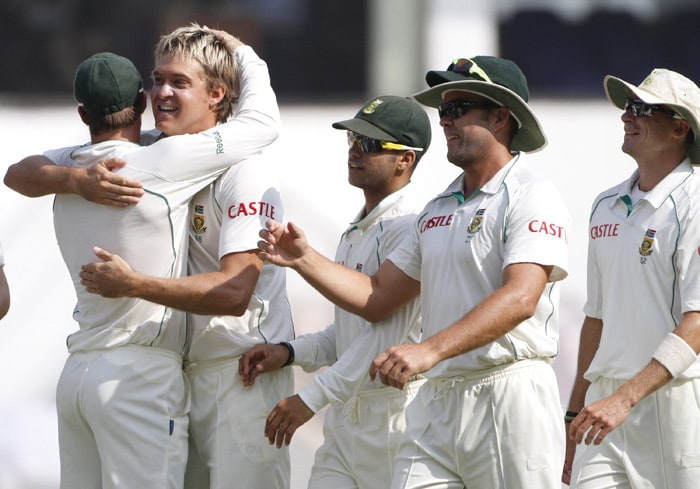 Paul Harris is congratulated by teammates on taking the wicket of Murali Vijay during the fourth day of the first Test against India in Nagpur. (AP Photo)