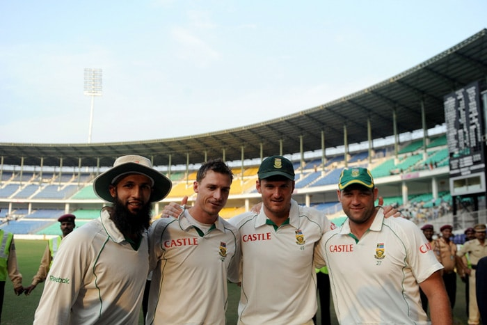 South African cricketers Hashim Amla, Dale Steyn, captain Graeme Smith and Jacques Kallis pose for a photograph after winning the first Test of the two-match series against India in Nagpur. South Africa thumped India by an innings and six runs despite a fighting century by Sachin Tendulkar on the fourth day of the first Test to go 1-0 up in the two-match series. (AFP Photo)