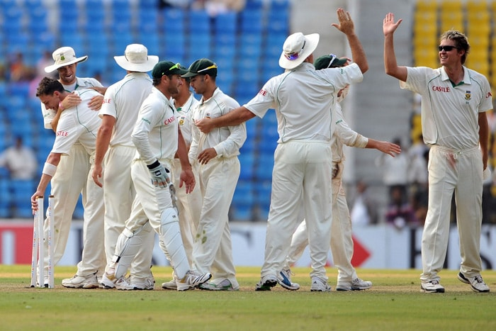 South African cricketers celebrate their win over India in the first cricket Test match of the two-match series in Nagpur. (AFP Photo)