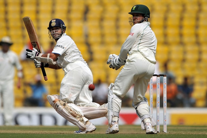 Sachin Tendulkar plays a shot past Mark Boucher on the fourth day of the first Test match between India and South Africa in Nagpur. (AFP Photo)