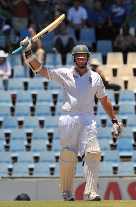 Graeme Smith celebrates after reaching 50 on the second day of the first Test between South Africa and India at the SuperSport Park in Centurion. (AFP Photo)