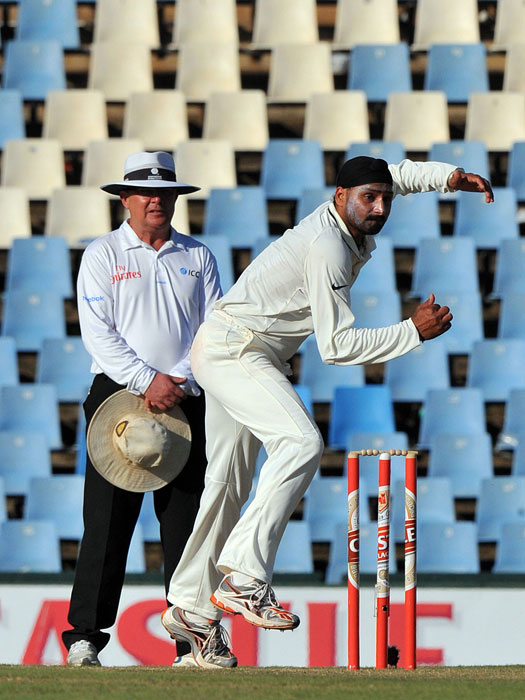Harbhajan Singh bowls to Hashim Amla during the second day of the first Test between India and South Africa at the SuperSport Park in Centurion. (AFP Photo)