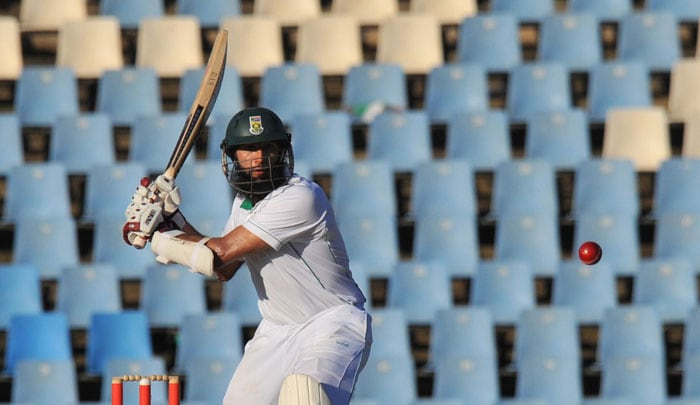 Hashim Amla plays during the second day of the first Test between India and South Africa at the SuperSport Park in Centurion. (AFP Photo)
