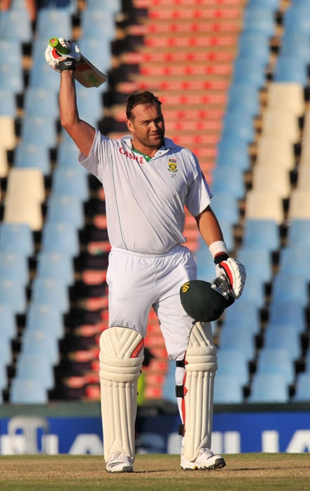 Jacques Kallis raises his bat after scoring a century on the second day of the first Test between India and South Africa at the SuperSport Park in Centurion. (AFP Photo)