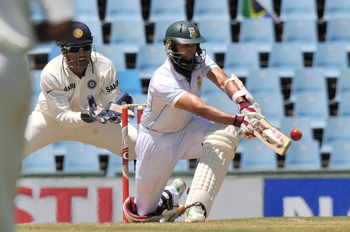 Hashim Amla plays a shot off the bowling of Harbhajan Singh on the second day of the first Test between India and South Africa at the SuperSport Park in Centurion. (AFP Photo)