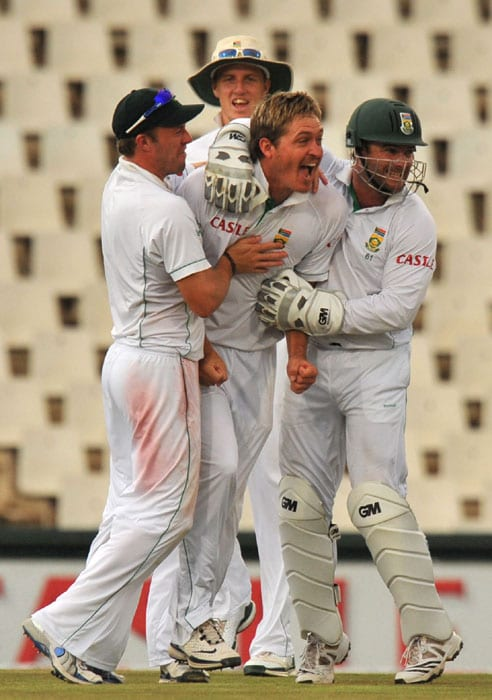 South African Paul Harris is ecstatic after dismissing Indian Harbhajan Singh for 1 run on the fourth day of the first Test at SuperSport Park in Centurion. (AFP Photo)
