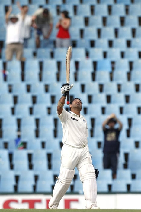 India's batsman Sachin Tendulkar looks up as he celebrates his century on the fourth day of the first Test at SuperSport Park in Centurion. (AP Photo)