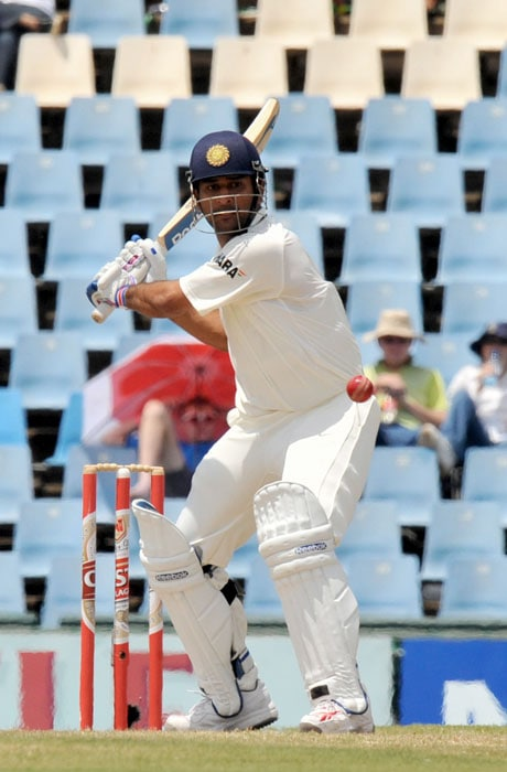 Indian Captain Mahendra Singh Dhoni plays a shot off a ball delivered by South Africa's Morne Morkel on the fourth day of the first Test at SuperSport Park in Centurion. (AFP Photo)