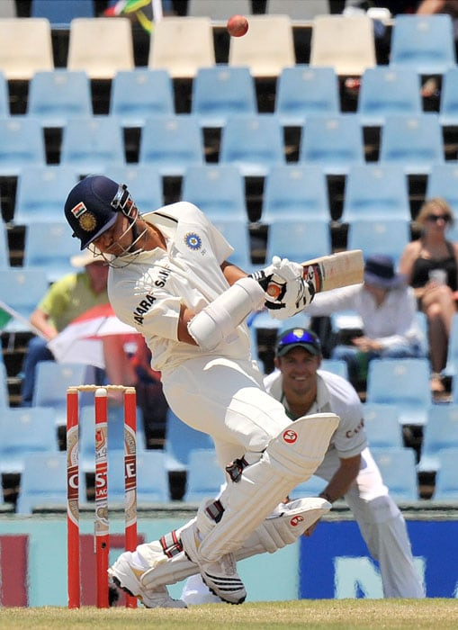 Indian Suresh Raina tries to avoid a bouncer from South African batsman Jacques Kallis on the fourth day of the first Test at SuperSport Park in Centurion. (AFP Photo)