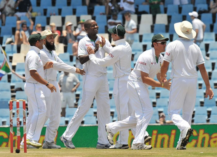 South Africa's Lonwabo Tsotsobe(C) is congratulated by teamates for the dismissal of India's VVS Laxman on the fourth day of the first Test at SuperSport Park in Centurion. (AFP Photo)