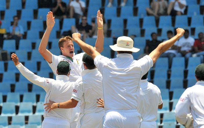 South African bowler Morne Morkel is congratulated by teammates for the dismissal of Indian cricketer Rahul Dravid on the fourth day of the first Test at SuperSport Park in Centurion. (AFP Photo)
