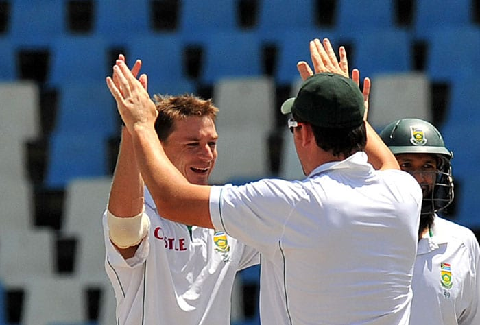 South African bowler Dale Steyn is congratulated by teammates for getting out Indian Jaidev Unadkat on the fifth day of the first Test at SuperSport Park in Centurion. (AFP Photo)
