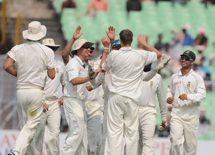 South African cricketers celebrate the dismissal of Murali Vijay during the second day of the second Test between India and South Africa at the Eden Gardens Stadium in Kolkata. (AFP Photo)