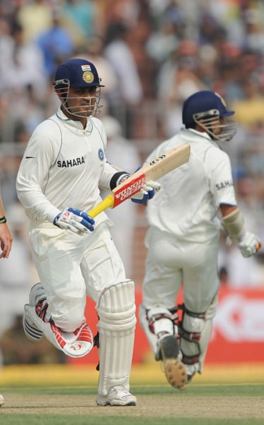 Virender Sehwag and Gautam Gambhir take a short run during the second day of the second Test between India and South Africa at the Eden Gardens Stadium in Kolkata. (AFP Photo)