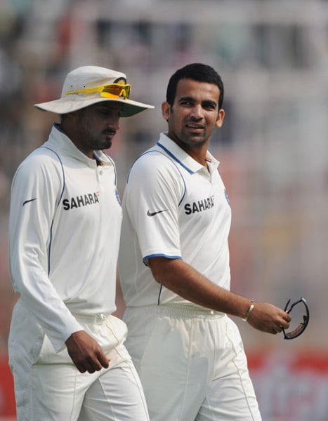 Harbhajan Singh and Zaheer Khan walk during the second day of the second Test between India and South Africa at the Eden Gardens Stadium in Kolkata. (AFP Photo)