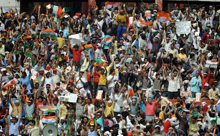 Indian cricket fans cheer as Sachin Tendulkar bats on the second day of the second Test between India and South Africa at the Eden Gardens Stadium in Kolkata. (AFP Photo)