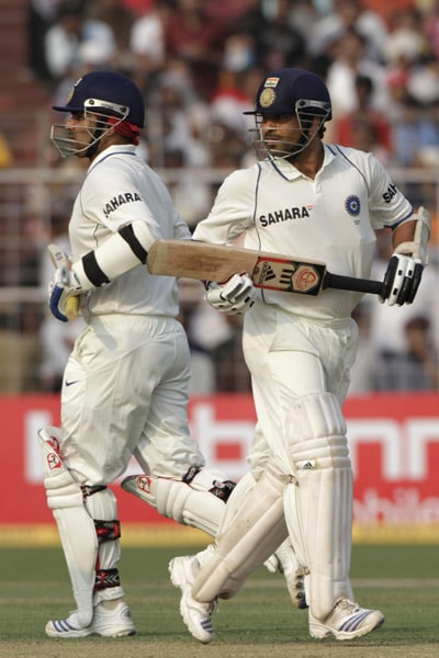 India's Sachin Tendulkar and Virender Sehwag run between the wickets during second day's play of the second Test against South Africa in Kolkata. (AP Photo)