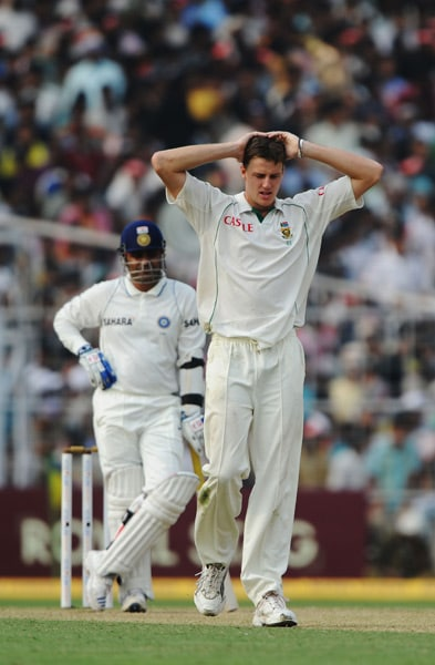 Morne Morkel gestures after a misfield as Virender Sehwag looks on during the second day of the second Test between India and South Africa at the Eden Gardens Stadium in Kolkata. (AFP Photo)